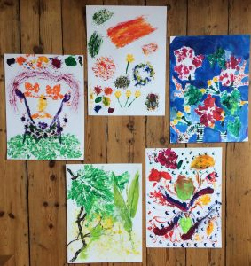 Image of Oakleaf client's colourful paintings